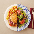Low fat salad against greasy burger — Stock Photo #36762389