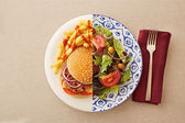 Low fat salad against greasy burger — Foto de Stock