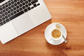 Having coffee in front of computer — Stock Photo