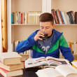 Stock Photo: Male teenager drinking coke while studying