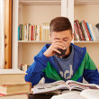 Male teenager drinking coke while studying — Stock Photo #37042331