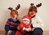 Santa Claus baby and siblings — Stock Photo