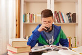 Male teenager drinking coke while studying — Foto de Stock