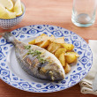 Stock Photo: Fried gilt head bream with potatoes