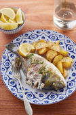 Fried gilt head bream with potatoes — Stock Photo