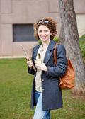 Female redhead student carrying notebook and coffee to go — Stock fotografie