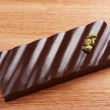 图库照片: Dark chocolate bar with pistachio