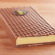 图库照片: Milk chocolate bar with lemon cream