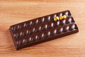 Dark chocolate bar with corn — Stock Photo