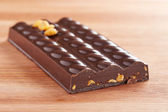 Dark chocolate bar with corn interior — Stock Photo