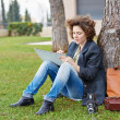 Female redhead art student drawing outdoors — Stock Photo #38328513