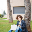 Female redhead art student drawing outdoors — Stock Photo