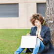 Female redhead art student drawing outdoors — Stock Photo #38646469