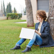 Female redhead art student drawing outdoors — Stock Photo #38646493