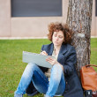 Female redhead art student drawing outdoors — Stock Photo #38646531