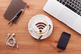 Free wifi area sign on a latte coffee — Stock Photo