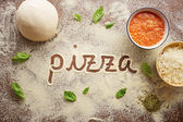 Pizza word written on table — Stock Photo
