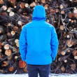 Young man staring at log stack — Stock Photo