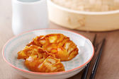 Cooked dim sums with soy sauce — Stock Photo