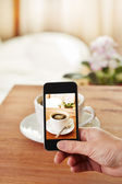 Smartphone taking picture of coffee — Stock Photo