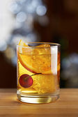 Old fashioned cocktail with a cherry — Стоковое фото