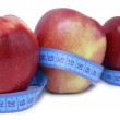 Tape measure and apples - Stock Photo