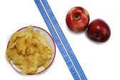 Tape between the chips and apples — Stock Photo