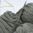 Stock Photo: Yarn for knitting and spokes