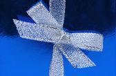 Bow of silver ribbon — Stock Photo
