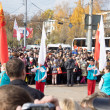 TVER - OCTOBER 11: People await arrival of Olympic flame — Stock Photo #33150881
