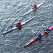 Rowers accompanying the Olympic torch — Stock Photo
