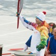 Torchbearer Ignat Kovalev on a boat with a dragons head — Foto de Stock