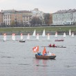 Small sailboats in the Olympic torch relay floating on the Volga River — Stock fotografie