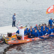 Torchbearer Ignat Kovalev on a boat with a dragons head — Stockfoto
