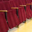 Empty red seats for cinema, theater or conference — Stock Photo