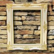 Golden frame on old brick wall - Stock Photo