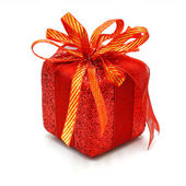 Christmas gift box with a gold ribbon bow, isolated on white bac — Stock Photo