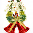 Stock Photo: Christmas decorations / ornaments: red bells on Christmas tree b