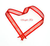 Red heart ribbon bow isolated on white background — Stock Photo