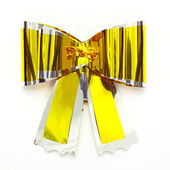 Gold bow isolated on white — Stock Photo