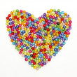Colorful beads heart shape isolated on white background — Stock Photo #13212196