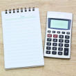 Royalty-Free Stock Photo: Calculator and notebook on table