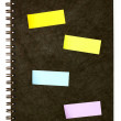 Stock Photo: Black spiral note book and post it