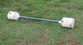 D.I.Y Barbell on green grass — Stock Photo