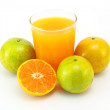 Tangerines and juice glass isolated on white background - Stock Photo