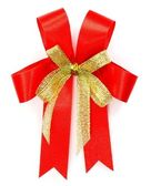 Bright red bow over white background — 图库照片
