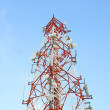 Red and white tower of communications — Stok fotoğraf