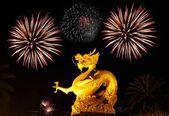 Golden gragon statue with fireworks, Phuket Thailand — Stock Photo