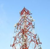 Red and white tower of communications — Stock Photo