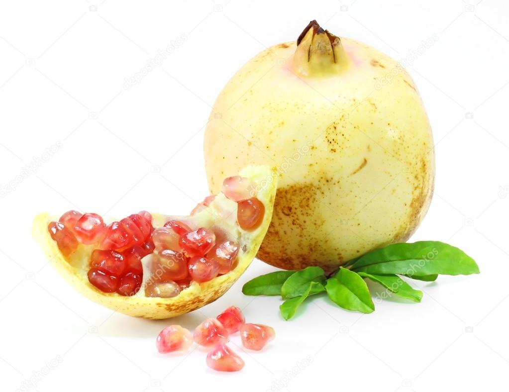 Pomegranate fruits with green leaf and cuts isolated on white background   Stock Photo #13294908
